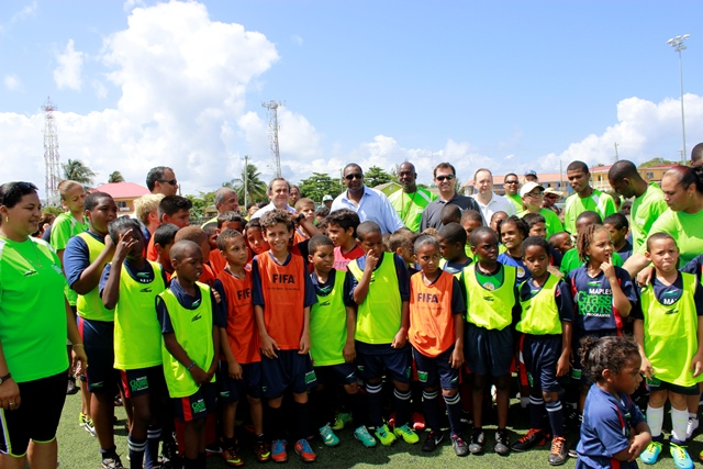 CONCACAF and CIFA President Jeffrey Webb and UEFA President Michel Platini share a photo with the participants of the Cayman grassroots Festival