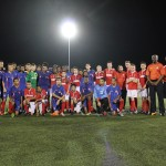 Charlton Athletic and Cayman Islands pose for photos after the match